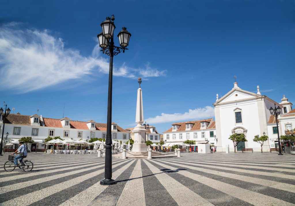 VILA REAL DE SANTO ANTONIO, PORTUGAL - SEP 23 2015.  The attractive paving of the town's main plaza, in Vila Real de Santo Antonio. The most South Eastern town of Portugal. A local man can be seen cycling across the square.