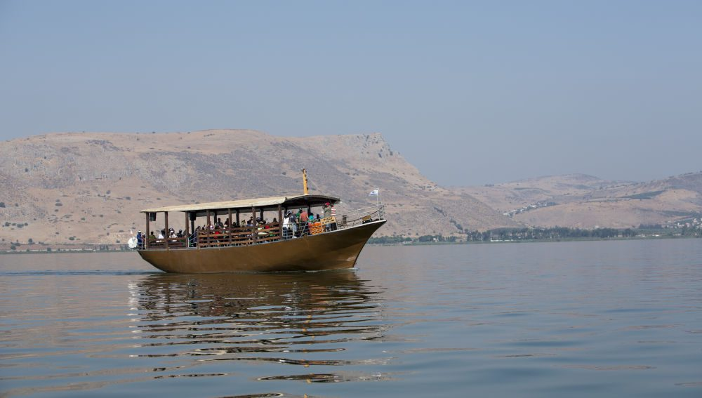 The Sea of Galilee, also Kinneret, Lake of Gennesaret, or Lake Tiberias, is the largest freshwater lake in Israel, and it is approximately 53 km (33 mi) in circumference, about 21 km (13 mi) long, and 13 km (8.1 mi) wide. The lake has a total area of 166 km2 (64 sq mi), and a maximum depth of approximately 43 m (141 feet). At 211.315 metres (693.29 ft) below sea level, it is the lowest freshwater lake on Earth and the second-lowest lake overall (after the Dead Sea, a saltwater lake). The lake is fed partly by underground springs although its main source is the Jordan River which flows through it from north to south.The picture shows a Pilgrim' s boat on the lake. Photo by Itamar Grinberg.